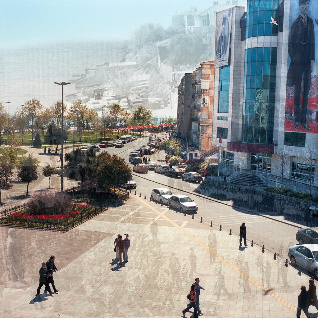 Kartal Meydanı, Kartal (Istanbul), Turquie. Palimpseste façonné à partir de mon image de la Place de Kartal (2014) et d'une image N&B montrant cette même place lors d'une Fête de la République dans les années 1960 (archives de la Mairie de Kartal, collection Studio Çiçek). Située sur la rive asiatique d'İstanbul, Kartal a entrepris de nombreux travaux de développement urbain et d'infrastructure routière afin de devenir une ville « moderne ». La Place de Kartal était beaucoup plus modeste, sur les bords de la Mer de Marmara, avec des bâtiments d'un étage construits sur une colline surplombant une petite plage. Ces dernières années, de grands travaux de rénovation urbaine ont repoussé la mer d'une trentaine de mètres. La place a été transformée en large esplanade piétonnière bétonnée. Les travaux ont fait disparaître la plage et arasé la colline. Des immeubles et bâtiments modernes, dont la nouvelle Mairie, se sont matérialisés à leur place. ............................ Kartal Meydani, Kartal (Istanbul), Turkey. Palimpsest fashioned using my picture of Kartal Square (2014) and a B&W picture of the same square in the 1960s (courtesy the Kartal Mayor's Office). The older picture shows a ceremony on the same square commemorating the founding of the Turkish Republic. In the '60s, the square was much smaller and right on the Sea of Marmara. There was a tiny beach at the foot of one-story buildings perched on a slight hill. In recent years, important urban development projects have pushed the Marmara Sea back in order to create a concrete esplanade. In the process, the beach disappeared, the hillside was levelled and modern buildings materialized, including a new City Hall. Kartal is located on Istanbul's Asian side.